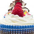 Stock Photo: Chocolat muffin whit whipped cream and rapsberry