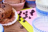 Chocolat drops and chocolat muffins — Stock Photo