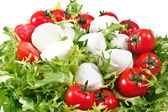 Fresh lettuces salad with fresh tomatoes and mozzarella — Stock Photo
