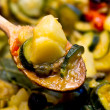 Ratatouille over spoon closeup — Stockfoto