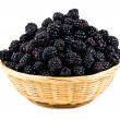 Beautiful blackberries  in basket isolated on white — Stock Photo