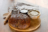 Bread on wooden board with oil and wather — Stock Photo