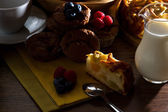 Homemade muffins and apple pie on early morning light — Photo