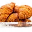 Croissant in plastic packaging - Stock Photo