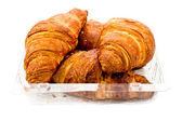 Croissant in plastic packaging — Photo