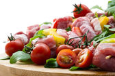 Fresh butcher cut meat assortment garnished close up selective f — Stock Photo