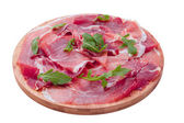 Delicious sliced ham on wooden board — Stock Photo