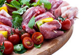 Fresh butcher cut and tomatoes meat assortment garnished — Stock Photo