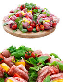 Fresh butcher cut meat assortment garnished on wooden board — Stock Photo