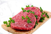 Hamburger of beef on wooden board with parsley — Stock Photo