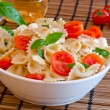 Pasta with basil, tomatoes and italian cheese called mozzarella — Stock Photo
