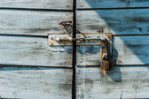 Rusty padlock on an old wooden door — Stock Photo