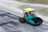 Pavement machine ready — Stock Photo