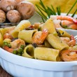 Shrimp and Mushroom Pasta in ceramic clay pot — Stock Photo