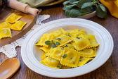 Homemade ravioli pasta with sage butter sauce , italian food — Stock Photo