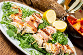 Grilled chicken on bamboo skewers — Stock Photo