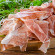 Stock Photo: Prosciutto crudo ham with green sald