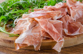 Prosciutto crudo ham with green sald — Stock Photo