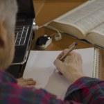 Elderly woman writing — Stock Photo #40111591
