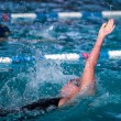 Woman swimming backstroke race — Stock Photo #45401029