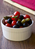 Black olives, cetrioli and red tomatoes — Stock Photo
