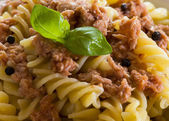 Italian pasta with tuna, black peppers and tomatoes — Stock Photo