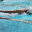Butterfly race in swimming pool — Stock Photo #46581327