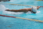 Butterfly race in  swimming pool — Stock fotografie