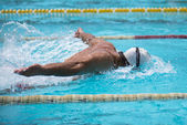 Man swims Butterfly — Stock Photo