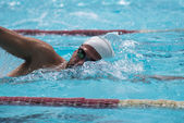 Free style swimmer on sun light — Stock Photo