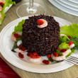 "Black rice called ""Venere rice"" on white plate with shrimps — Stock Photo #50652895"