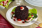 "Black rice called ""Venere rice"" on white plate with shrimps — Stock Photo"