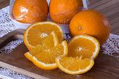 Oranges and orange vacuum package — Stock Photo