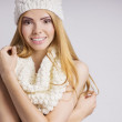 Young smiling woman in white hat and muffler — Stock Photo