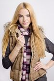Young woman in waistcoat and colorful muffler — Stock Photo