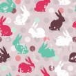 Stock Vector: Cute seamless pattern with bunnies