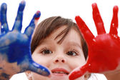 Happy smiling little girl playing with colors — Stock Photo