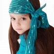 Portrait of a little fashionable girl in retro handkerchief who - Stock Photo