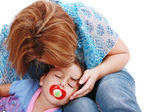 Affectionate Mother kissing her sleeping daughter — Stock Photo