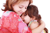 Mother and daughter hugging, isolated on white. Focus on the li — Stock Photo