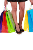 Beautiful woman with a lot of shopping bags on white background — Stock Photo