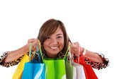 Beautiful Shopping Woman holding shopping bags looking to the ca — Stock Photo