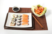 Composition sushi on a white background — Stock Photo