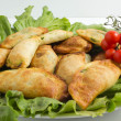 Italian panzerotti with ingredients — Stock Photo