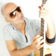 Guitarist on a white background — Stock Photo #14087990
