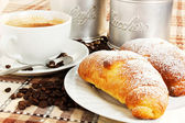 Brioches with cup of coffee and sugar — Stock Photo