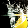 Stock Photo: Lemon and water bubbles on black background