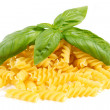 Heap of pasta with basil — Stock Photo