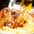 Baked chicken with french fries — Photo