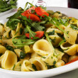 Orecchiette, with rucola salad and tomatoes — Stock Photo
